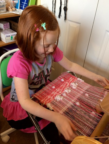 She's also weaving pink, just like Grandma.