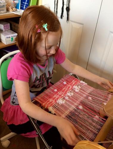 She's also weaving pink, just like Grandma.
