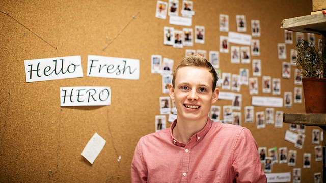 Henry in front of a HelloFresh noticeboard