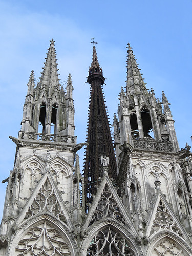 The exterior of the Rouen Cathedral showing the black cast-iron spire