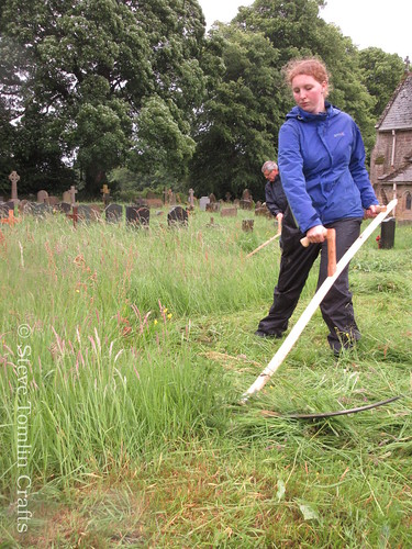 Scything wildflower meadow in churchyard