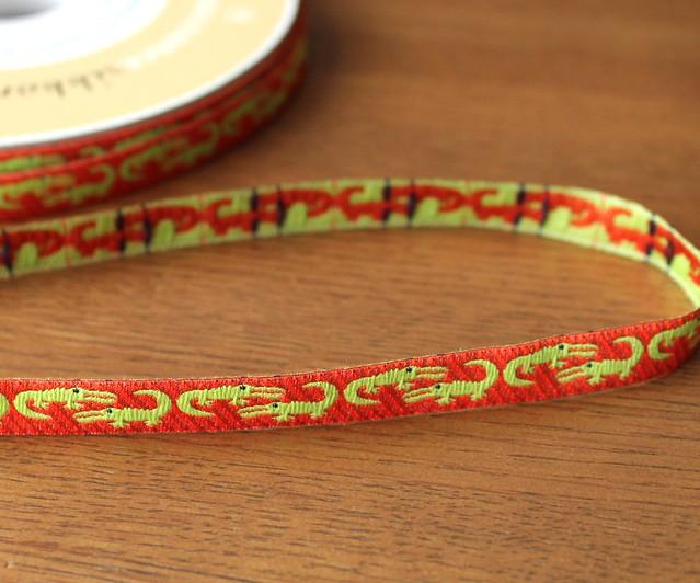 Renaissance Ribbons Folk Tails Orange Crocodile