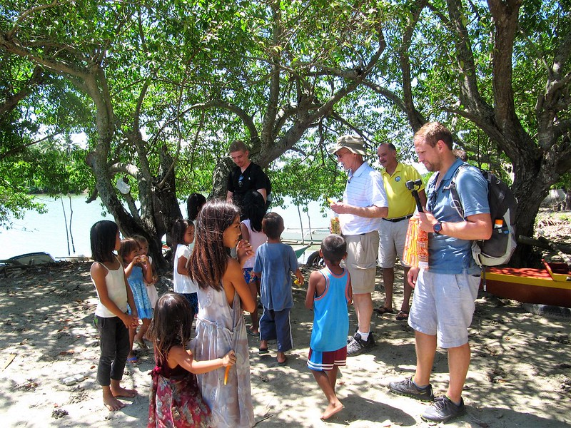 American visitors interacting with Sitio Baybay children
