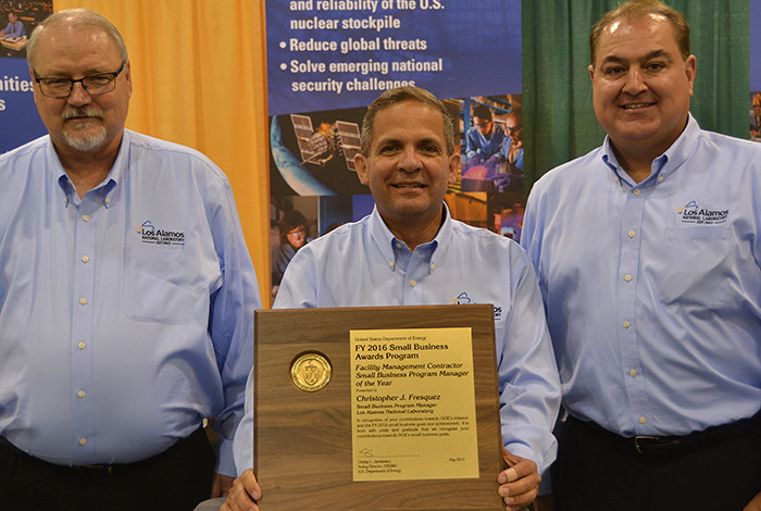 Chris Fresquez (center), Los Alamos National Laboratory Small Business Program Manager, is the recipient of the 2016 Small Business Program Manager of the Year Award given annually by the U.S. Department of Energy's Office of Small and Disadvantaged Business Utilization.
