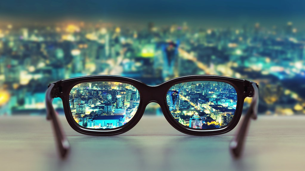 A view of a city at night through glasses