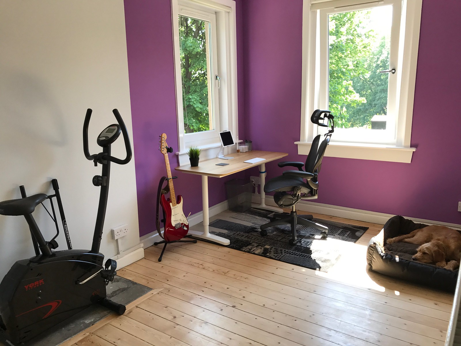 A wider angle of the final office, showing the exercise bike in place as per the concept.