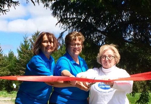 Gwen Devereaux Kathy OReilly and Shirley Dinsmore cut ribbon