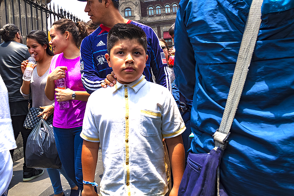 Boy outside Metropolitan Cathedral--Mexico City