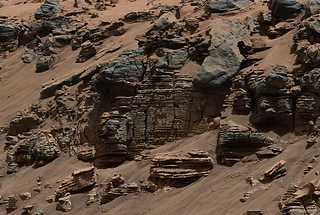 This evenly layered rock imaged in 2014 by the Mastcam on NASA's Curiosity Mars rover shows a pattern typical of a lake-floor sedimentary deposit near where flowing water entered a lake. Shallow and deep parts of an ancient Martian lake left different clues in mudstone formed from lakebed deposits. (Credit: NASA/JPL-Caltech/MSSS)