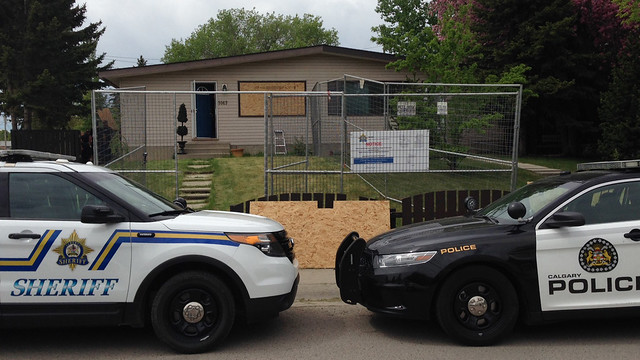 Alberta Sheriffs from the Safer Communities and Neighbourhoods (SCAN) unit and the Calgary Police Service closes a Calgary drug house.