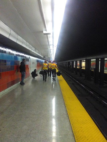 Maintenance crew on the platform, walking west