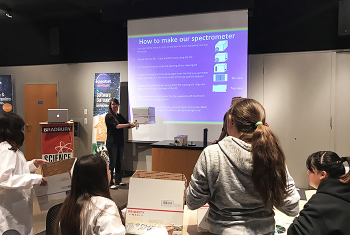 Girls from a Northern New Mexico school look on as Amanda Madden, of Los Alamos National Laboratory's Space Science & Applications group, demonstrates how to build a spectrometer.