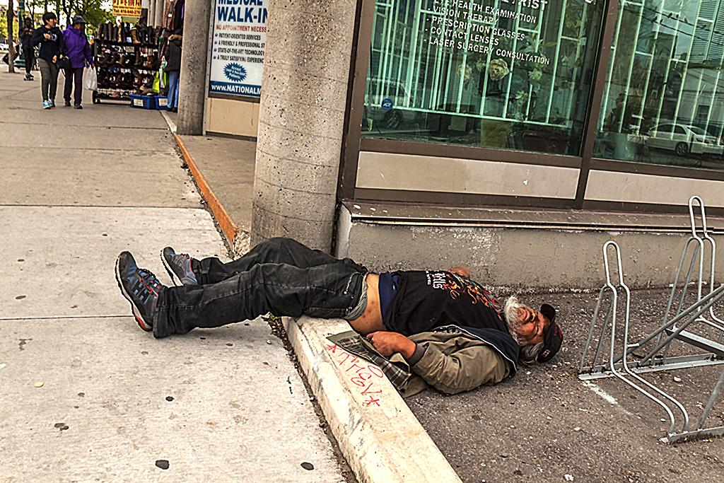 Man on ground at Spadina and D'Arcy--Toronto
