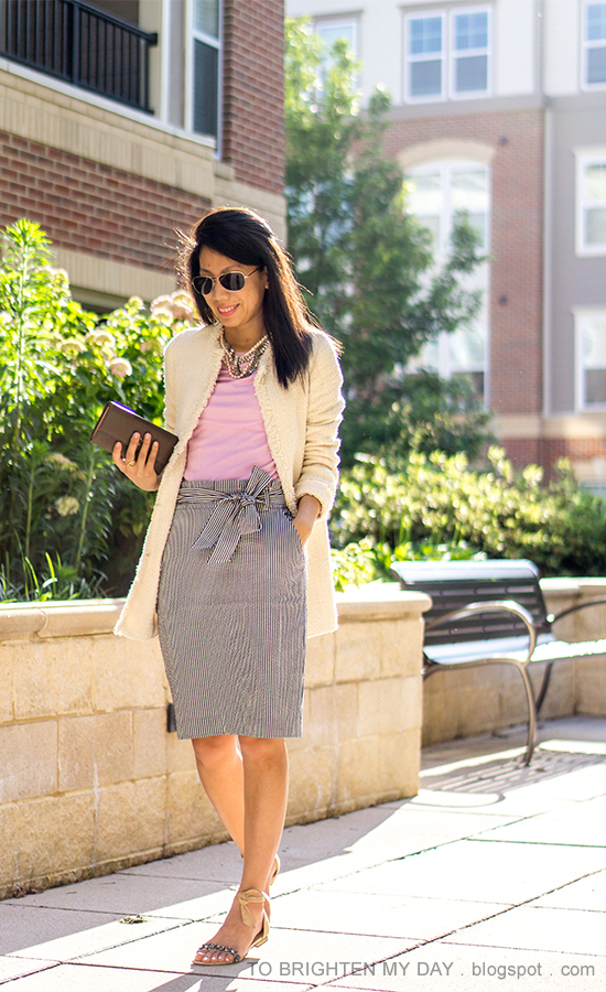 beige tweed jacket, mixed metal necklace, lavender top, striped paperbag pencil skirt with bow sash, taupe clutch, suede sandals with jewels