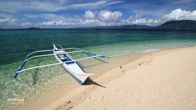 a fishing boat on one of Cobrador Island's immaculate white sand beaches