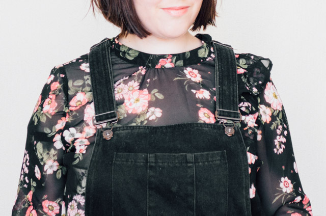 floral blouse and black denim dungaree dress