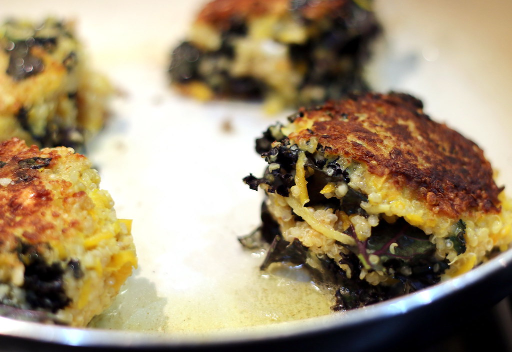 Squash and kale fritters in pan