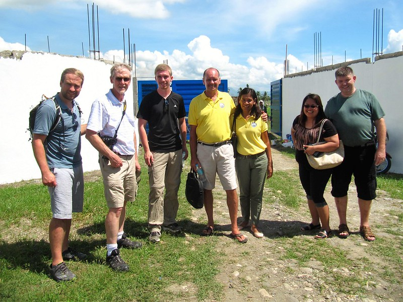 with friends Scott Ihle, Skip Slatton, Quinn Brandt, and Michael & Deborah Stock at the orphanage site