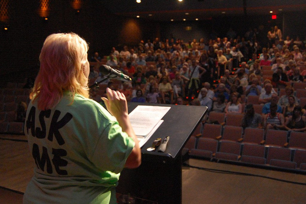 Main Street Director Sharon Jablonski talks to the audience in the CoMMA auditorium.