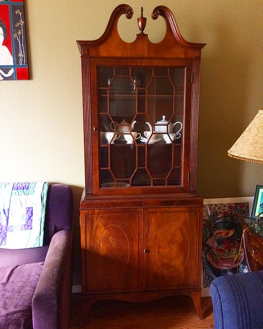We scored this sexy china cabinet and matching dining room set from our wedding photographer. They really class up the joint!