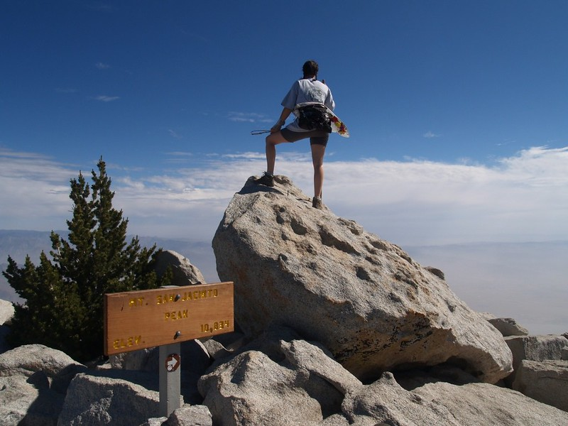 Vicki standing on the summit block of San Jacinto Peak - 10834 feet elevation