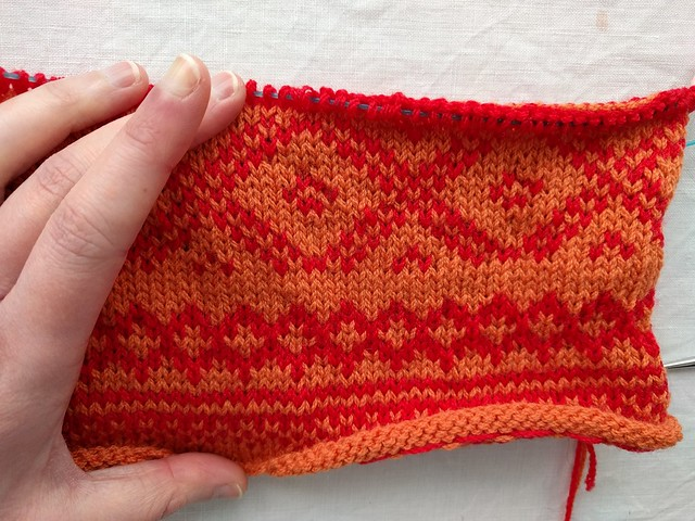 Orange and red knitted colourwork.