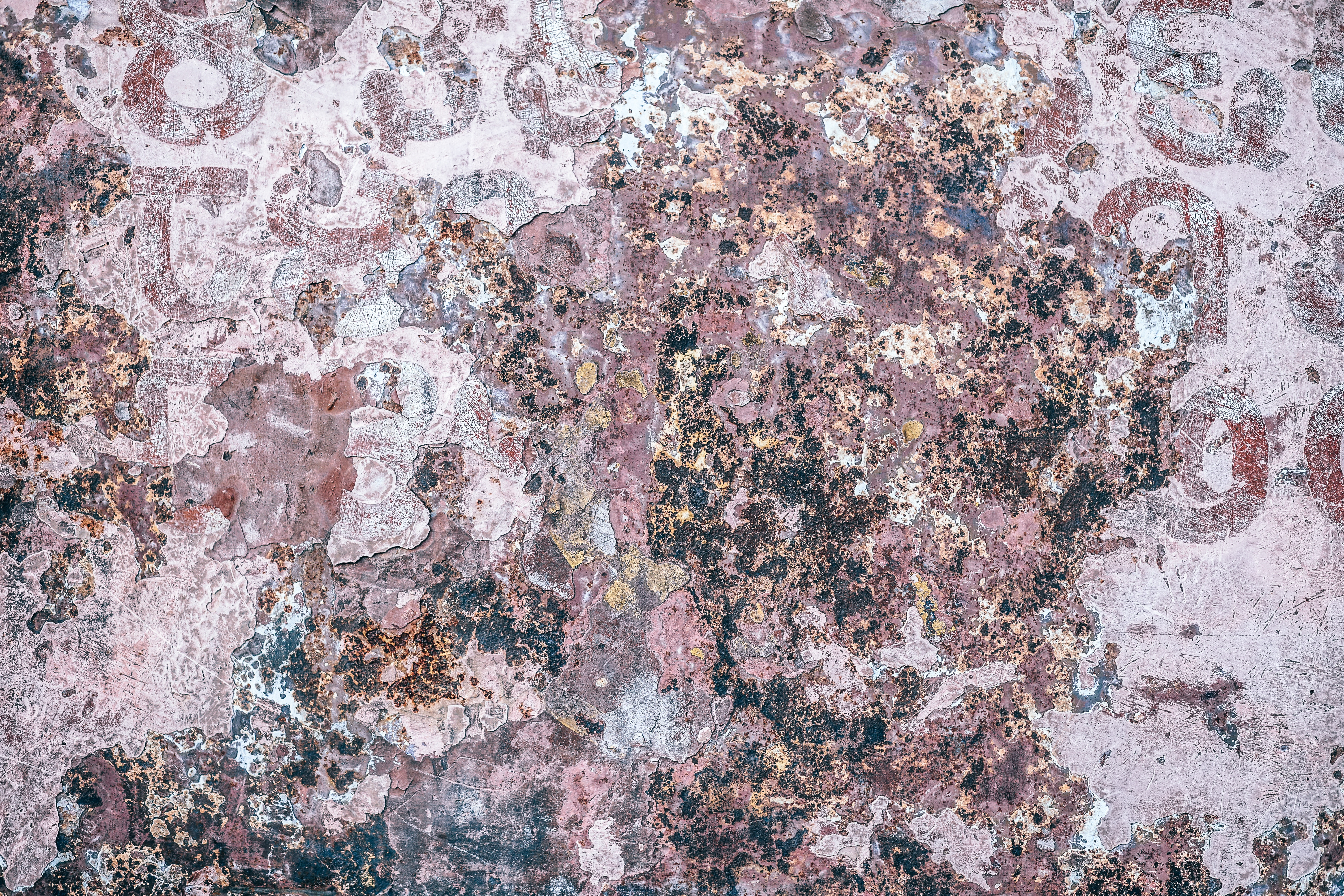 Pink, grungy texture that\'s been touched by time.