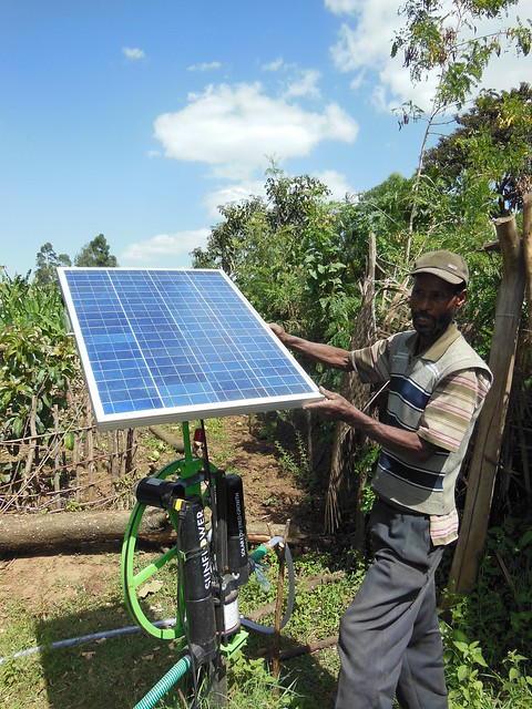 A farmers in Lemo with his newly installed Solar pump