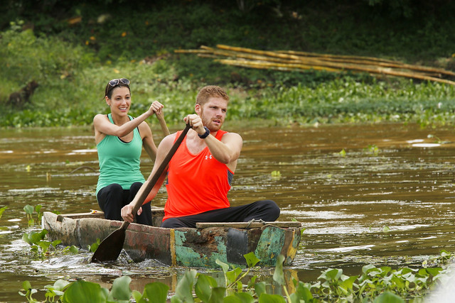 Brooke Camhi and Scott Flanary paddle a canoe.
