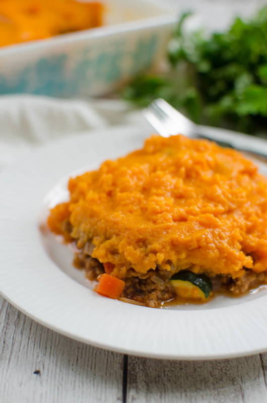 Paleo Shepherd's Pie - perfect comfort food! Beef and veggies in a rich tomato gravy and topped with mashed sweet potatoes!