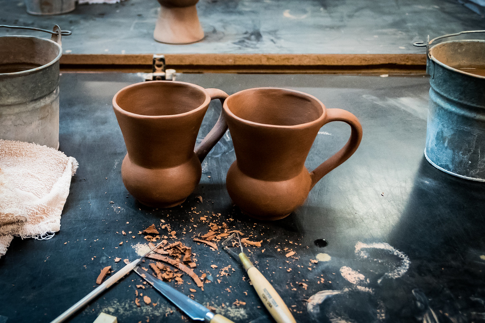 We smoothed and shaped these mugs ourselves! So fun!