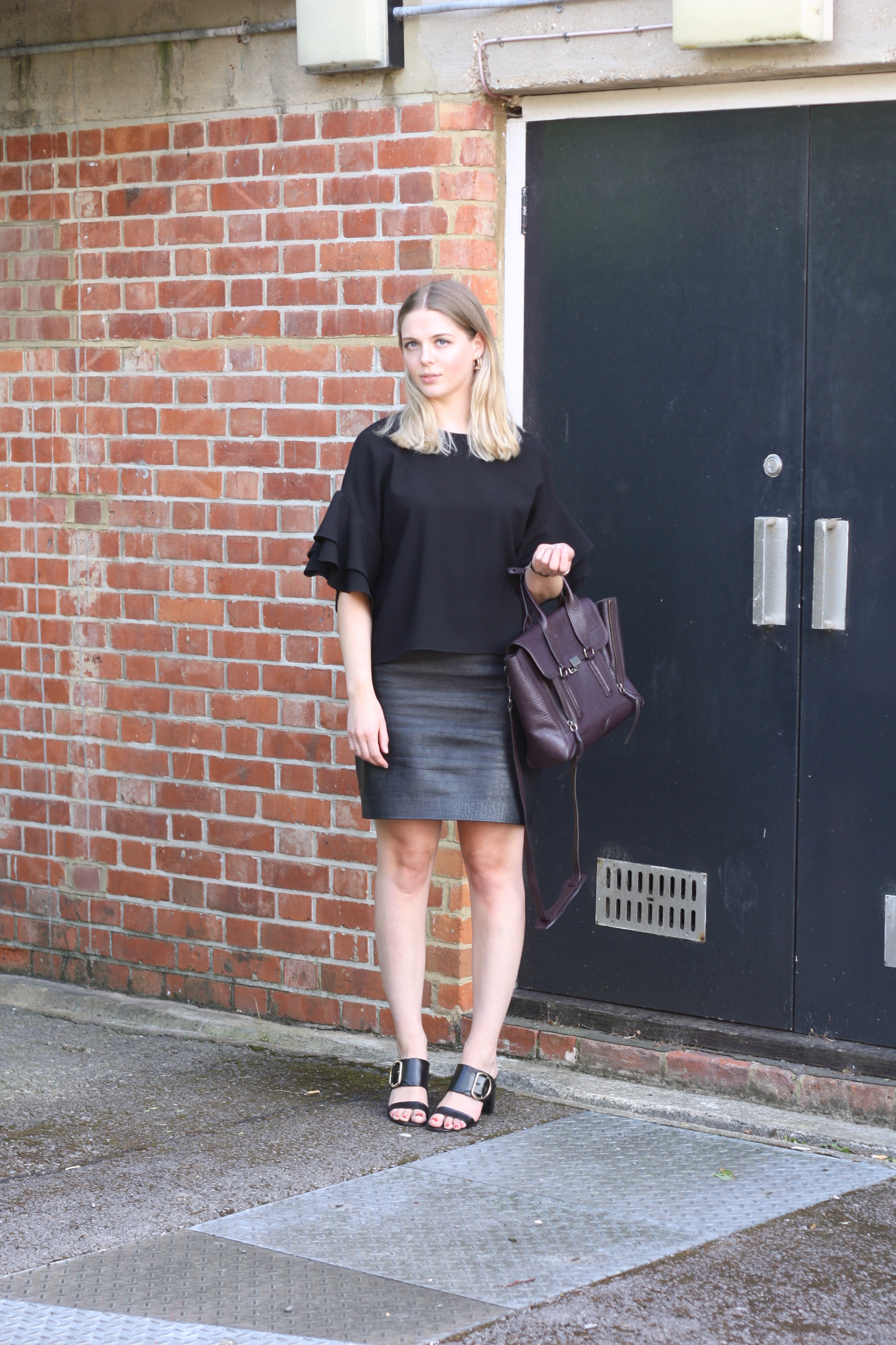 Topshop Boutique black leather skirt, Whistles gold buckle heels and 3.1 Phillip Lim Pashli medium bag