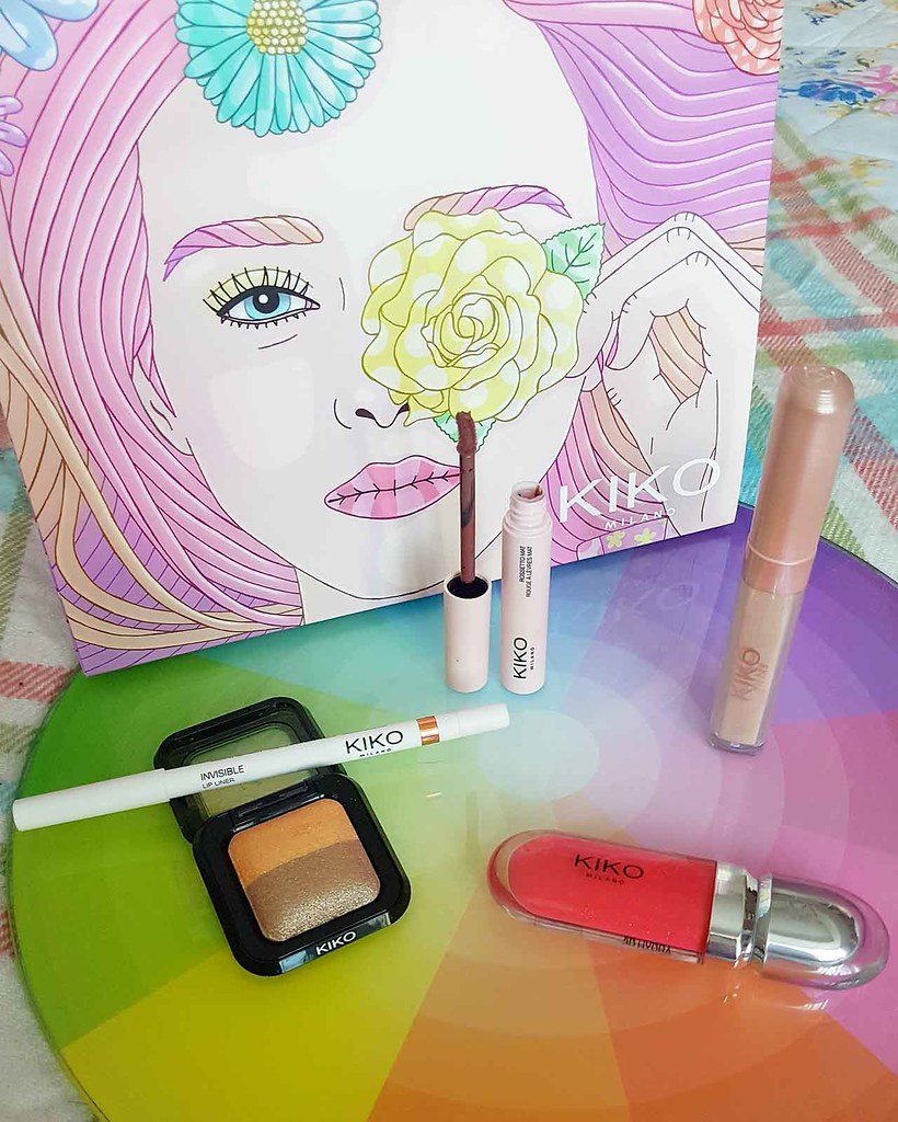 Discover One Of Italy's Finest Brands - Kiko Milano [Brand Focus]: All these items are still available in store and online – I also received the beautiful gift bag pictured! Working from left to right, the items pictured are: Bright Duo Baked Eyeshadow in Pearly Sand – Satin Taupe Invisible Lip Liner Less is Better Matte Lipstick in Impeccable Rosewood 3D Hydra Lipgloss in Golden Red Pearly Liquid Eyeshadow in Sparkling Champagne.