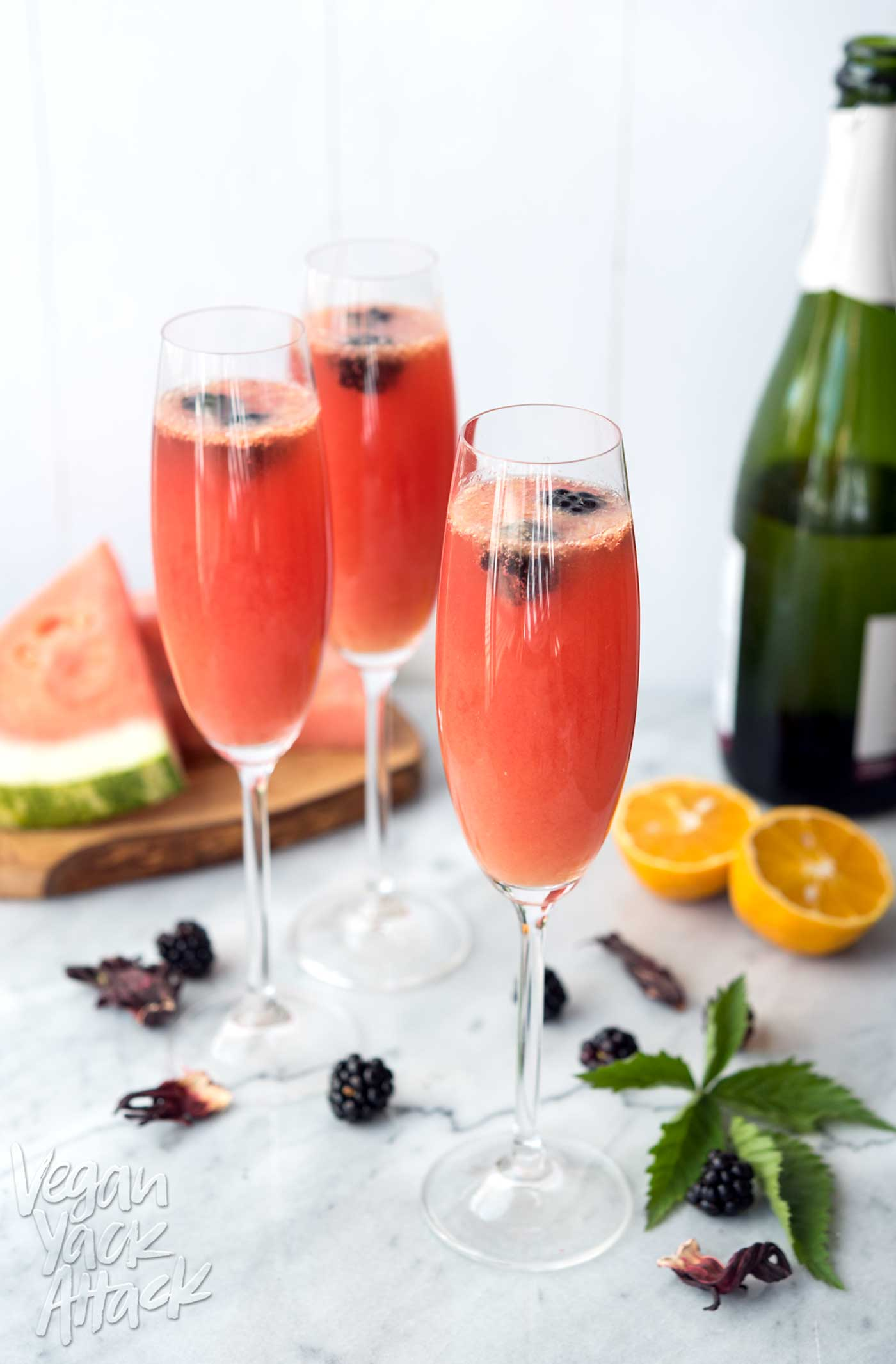 Refreshing watermelon, tart hibiscus tea, OJ and champagne make for the perfect, summer brunch beverage: Watermelon Hibiscus Mimosas! #vegan #allergenfriendly #brunch #drinks