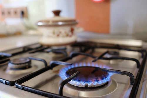 gas burning from a kitchen gas stove | by russeljones