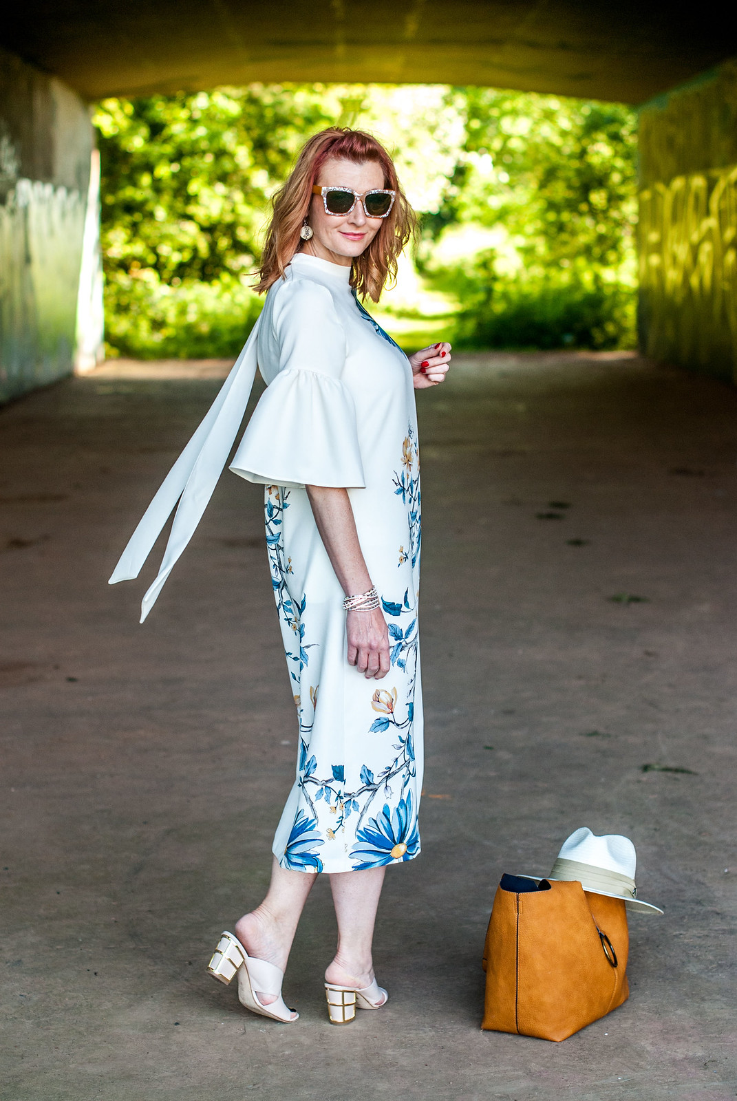 Wedding guest or garden party outfit: Marks & Spencer floral midi dress with flared sleeves \ nude cage heel mules \ pearl sunglasses | Not Dressed As Lamb, over 40 style