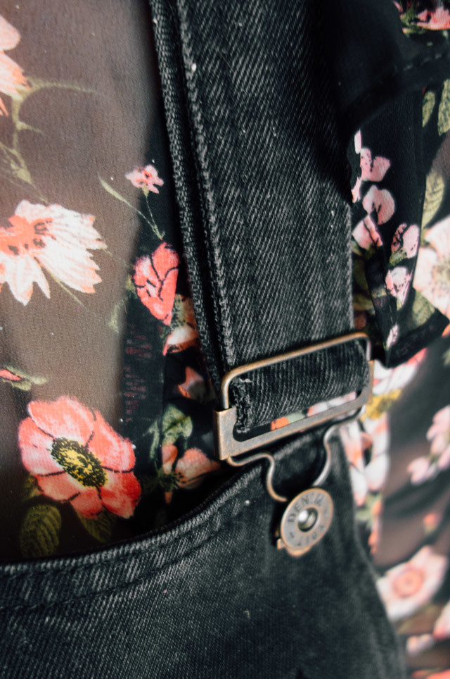 close up of dungaree dress buckle