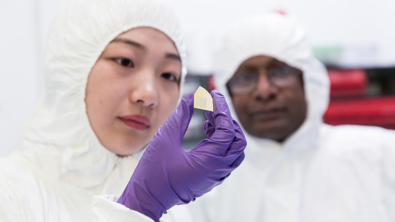 student in clean room with nanochip