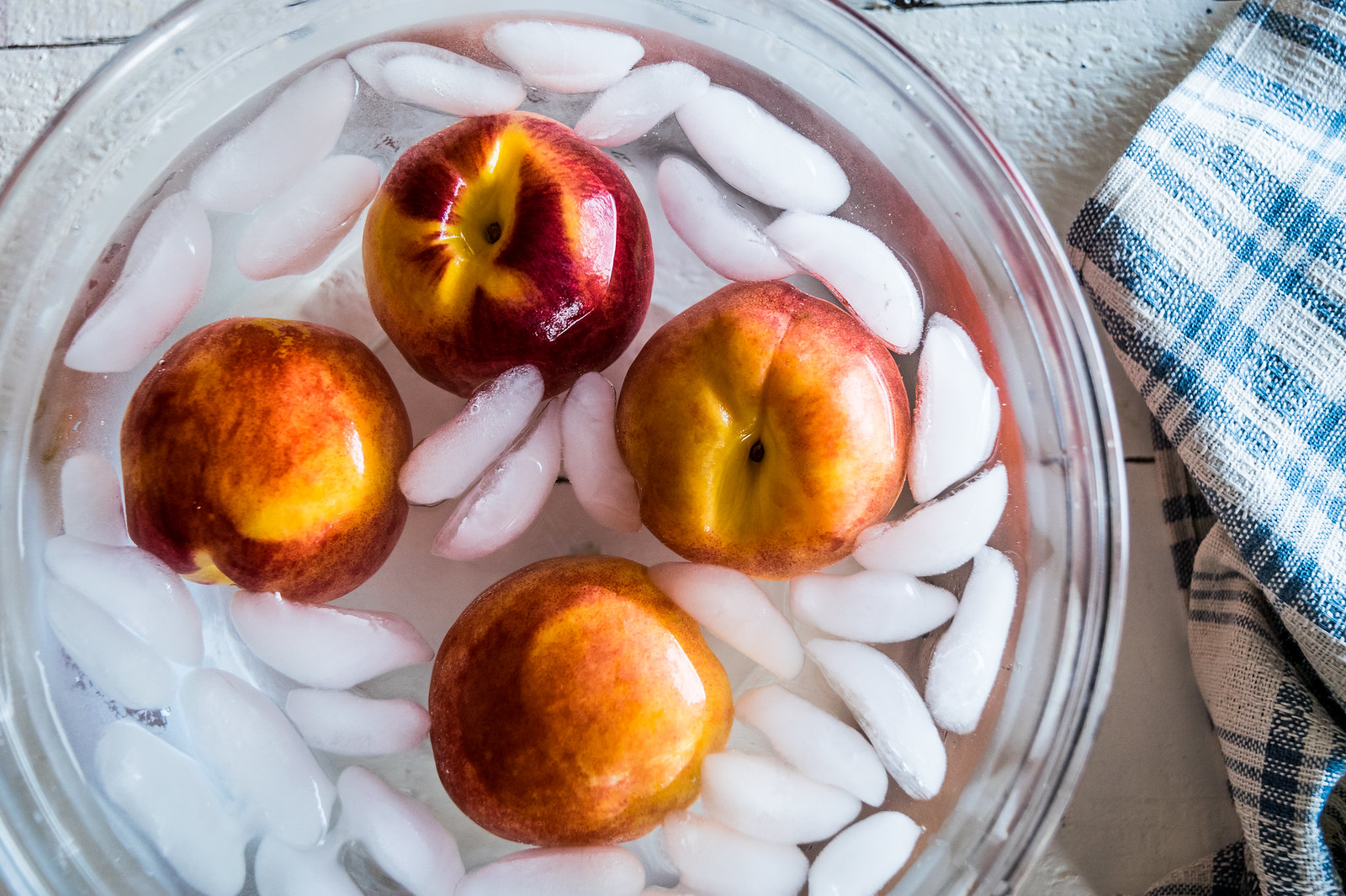 giving the peaches an ice bath after a dip in boiling water makes them easy to peel.