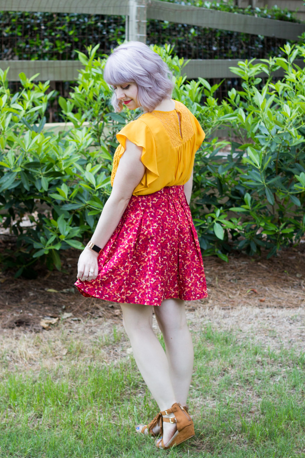 Orange Red Floral Skirt with Brown Wedge Sandals, a Yellow Shirt and Silvery Hair