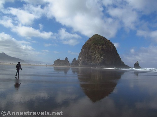 Reflections of Haystack Rock in the tidal flats of Cannon Beach, Oregon