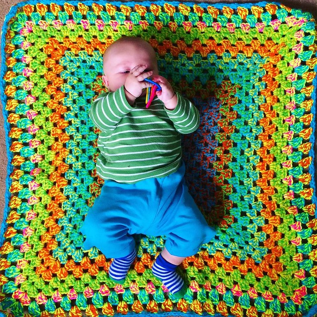 Baby M. on his colorful quilt from Aunt Kissy @dubtrance 💖✨✨