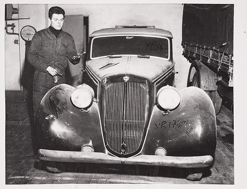 Photographer-unknown,-Benito-Mussolini's-dust-covered-motor-car-languishes-in-a-Milan-garage-ten-years-after-his-death,-1955