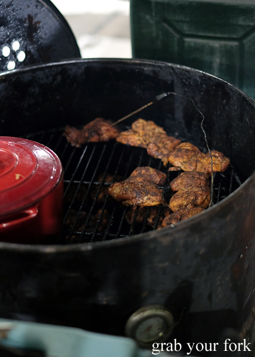 Smoked chicken thighs on the charcoal bbq at Paddy's Night Food Markets