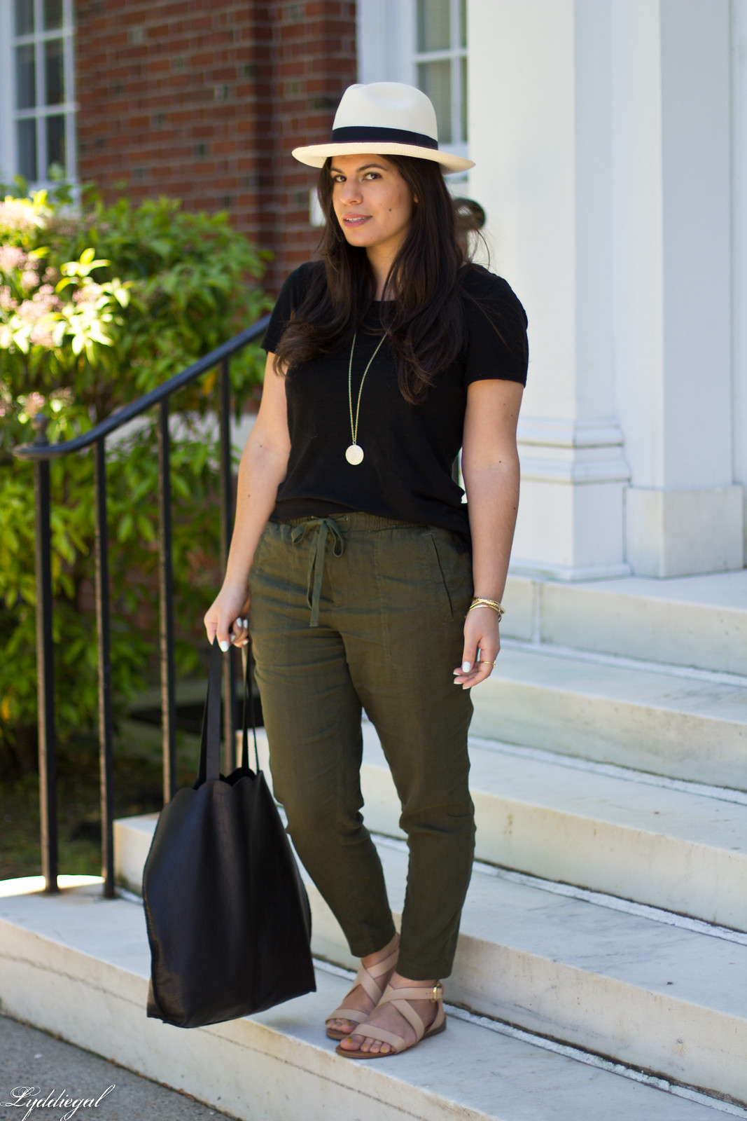 green linen pants, black tee, matine scalloped tote, panama hat-1.jpg