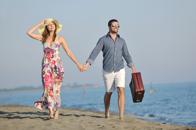bigstock-couple-on-beach-with-travel-ba-21894044