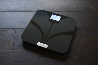 Weight Gurus black bathroom scale on wood floor | by yourbestdigs