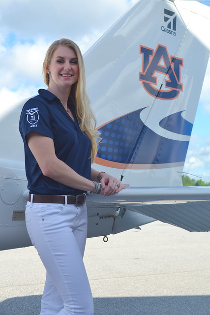 Ashley Tucker stands next to a Cessna Skyhawk 172 airplane.