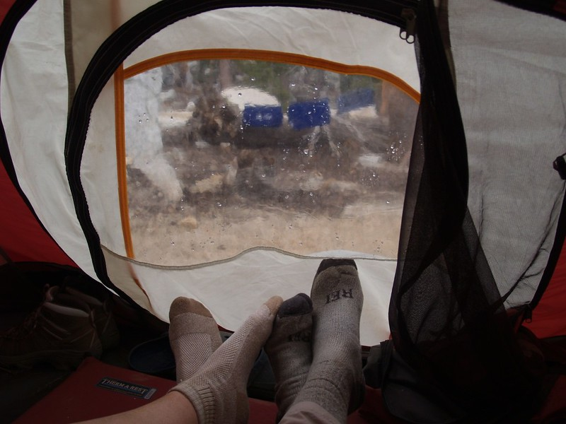 Hanging out, dry in our tent, as an afternoon thunderstorm rains on our drying laundry