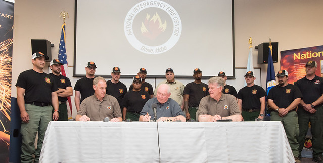 U.S. Department of Agriculture Secretary Sonny Perdue, Interior Secretary Ryan Zinke sign a memorandum to wildland fire leadership in Boise, Idaho